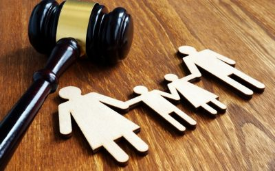 Family law concept. Wooden figures and gavel.