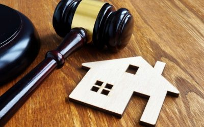 Real estate and property law. House model and gavel.